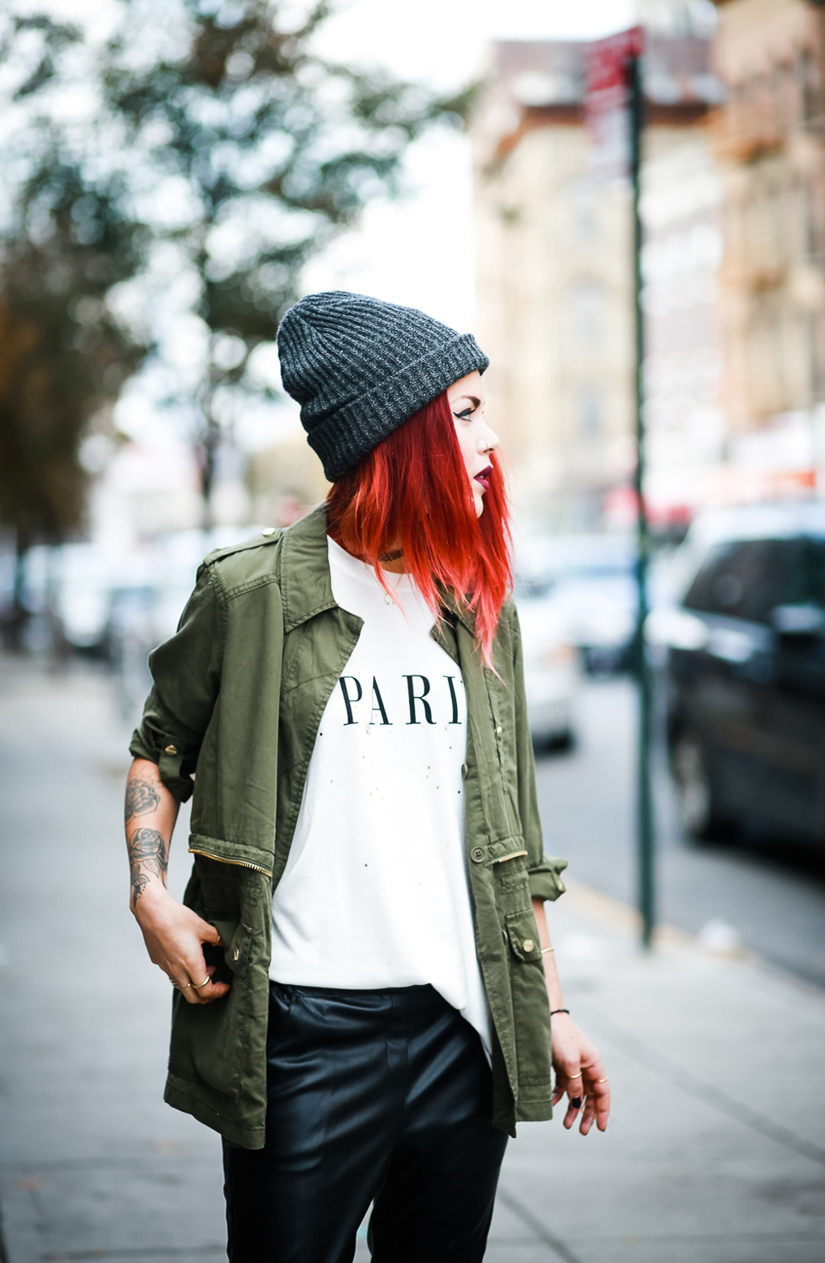 Le Happy wearing army jacket and beanie from River Island