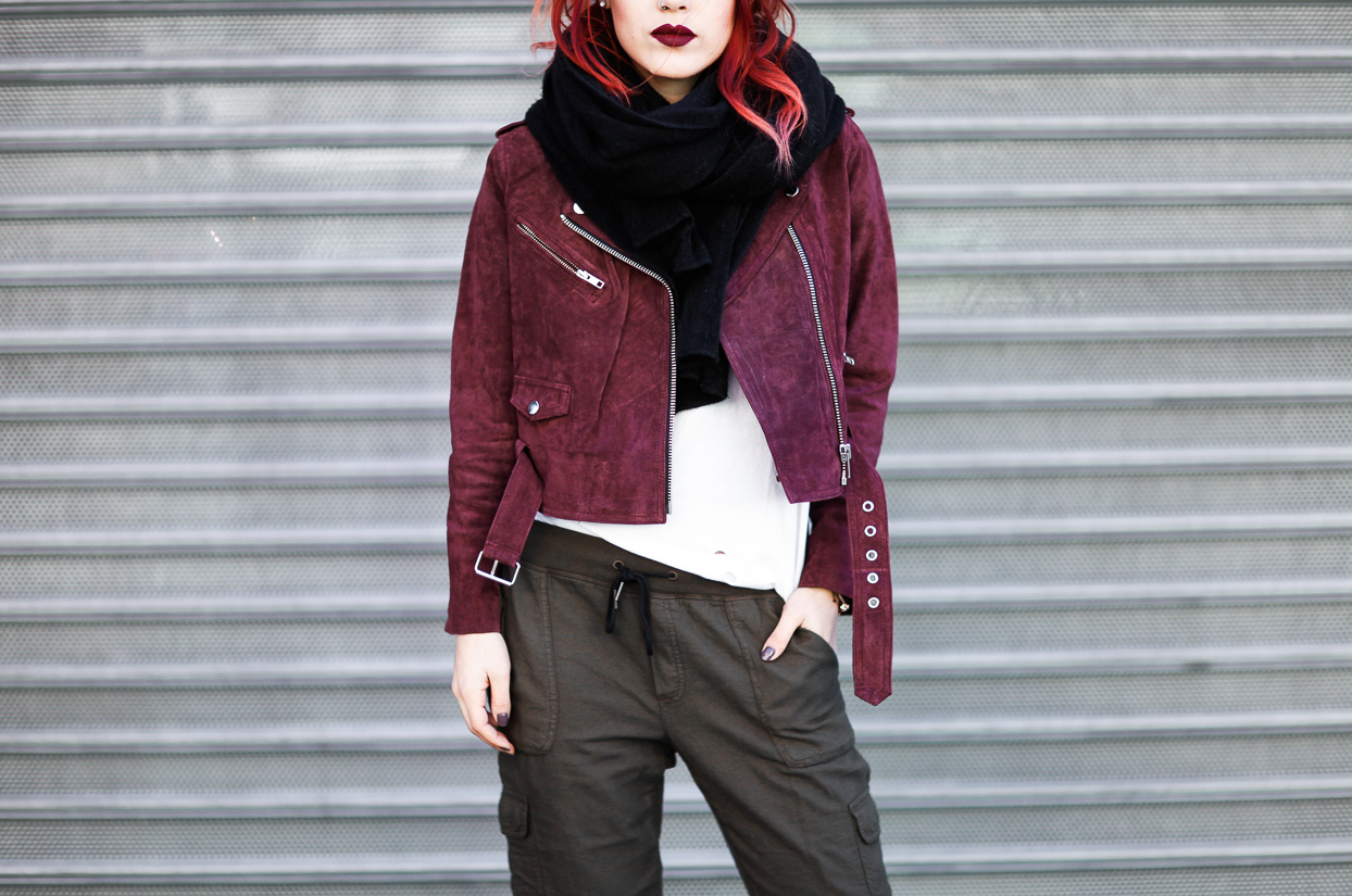 Le Happy wearing cargo pants and Obey Burgundy jacket