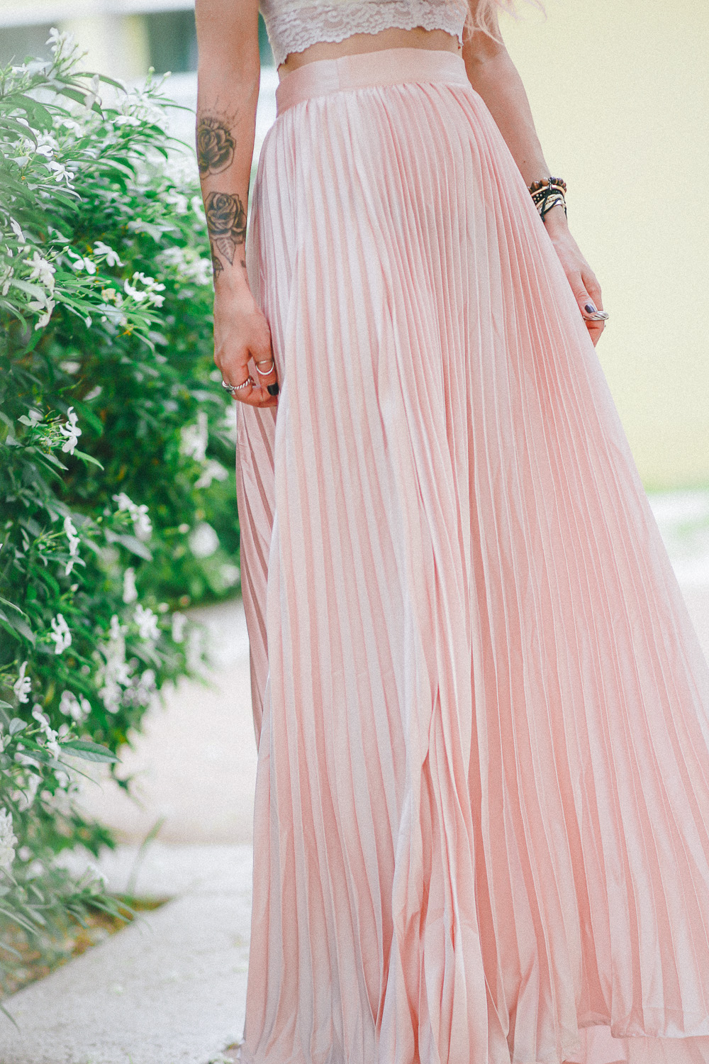 Le Happy wearing maxi pastel pleated skirt