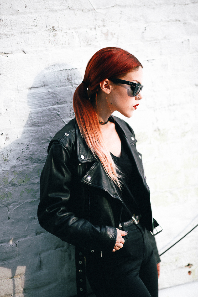 Le Happy wearing black biker motorcycle jacket