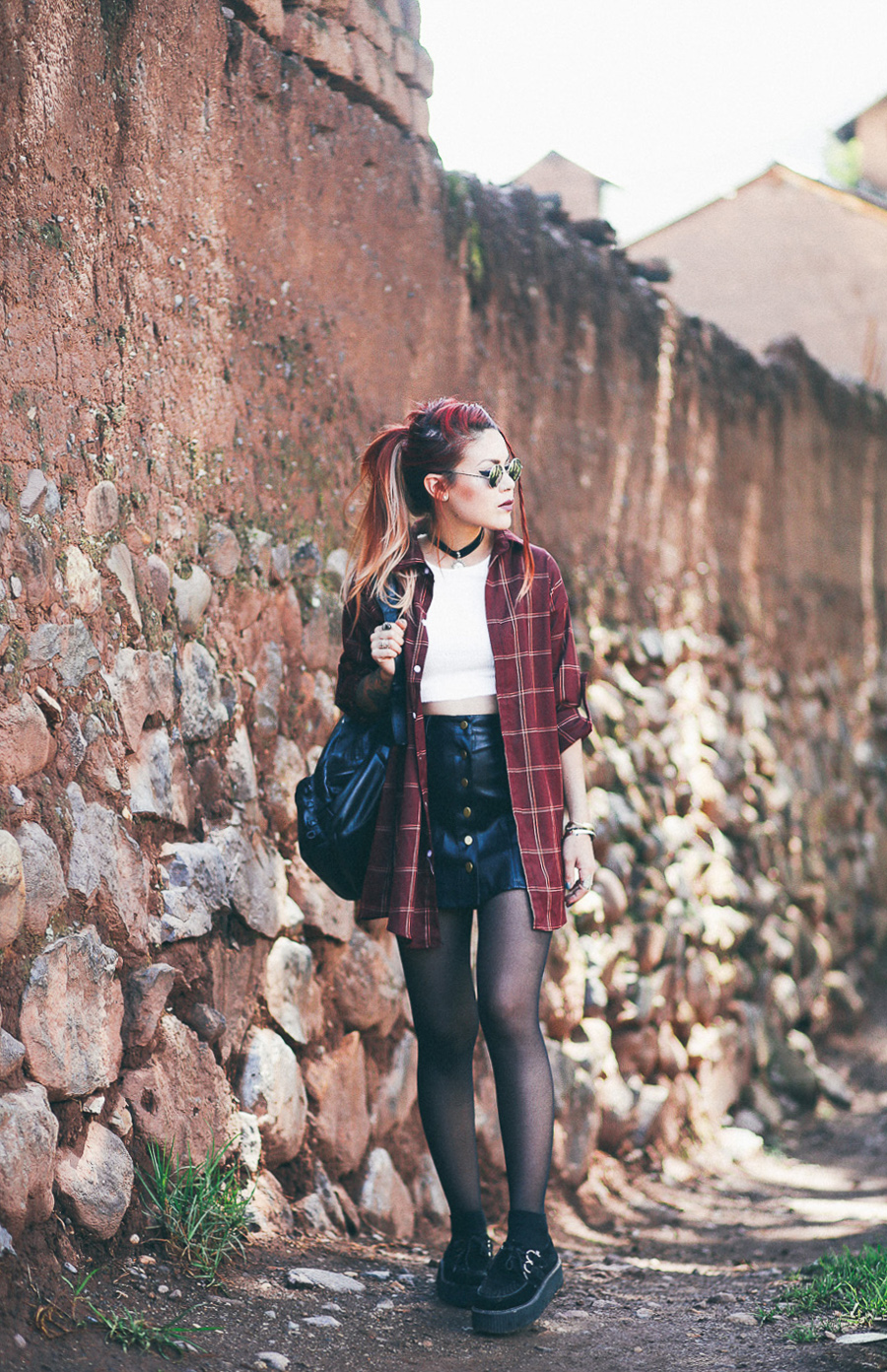 Le Happy wearing Lord and Taylor crop top with leather skirt in Cusco