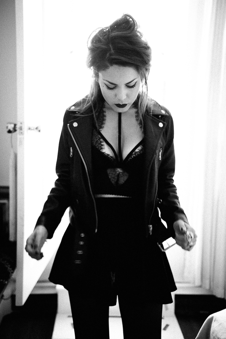 Le Happy wearing Nasty Gal biker jacket and lace corset