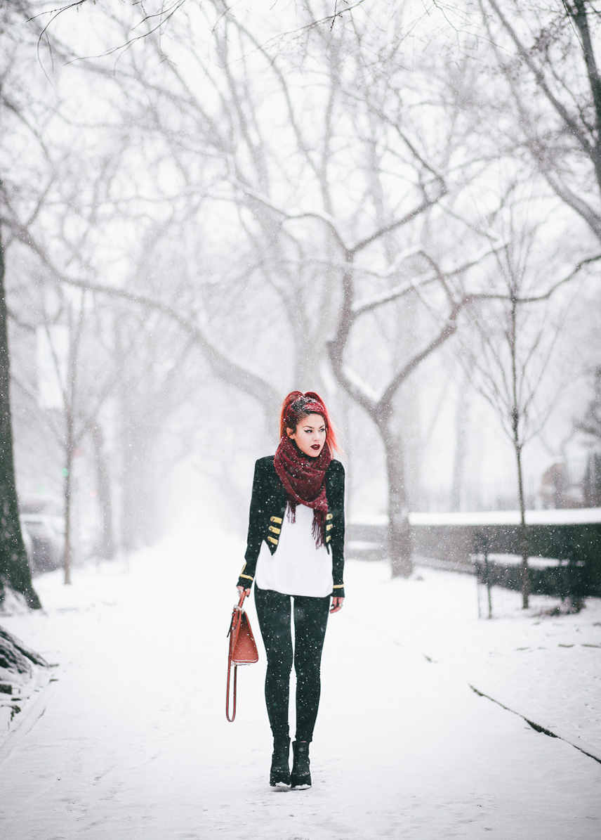 Le Happy wearing a military look in the snow in Central Park