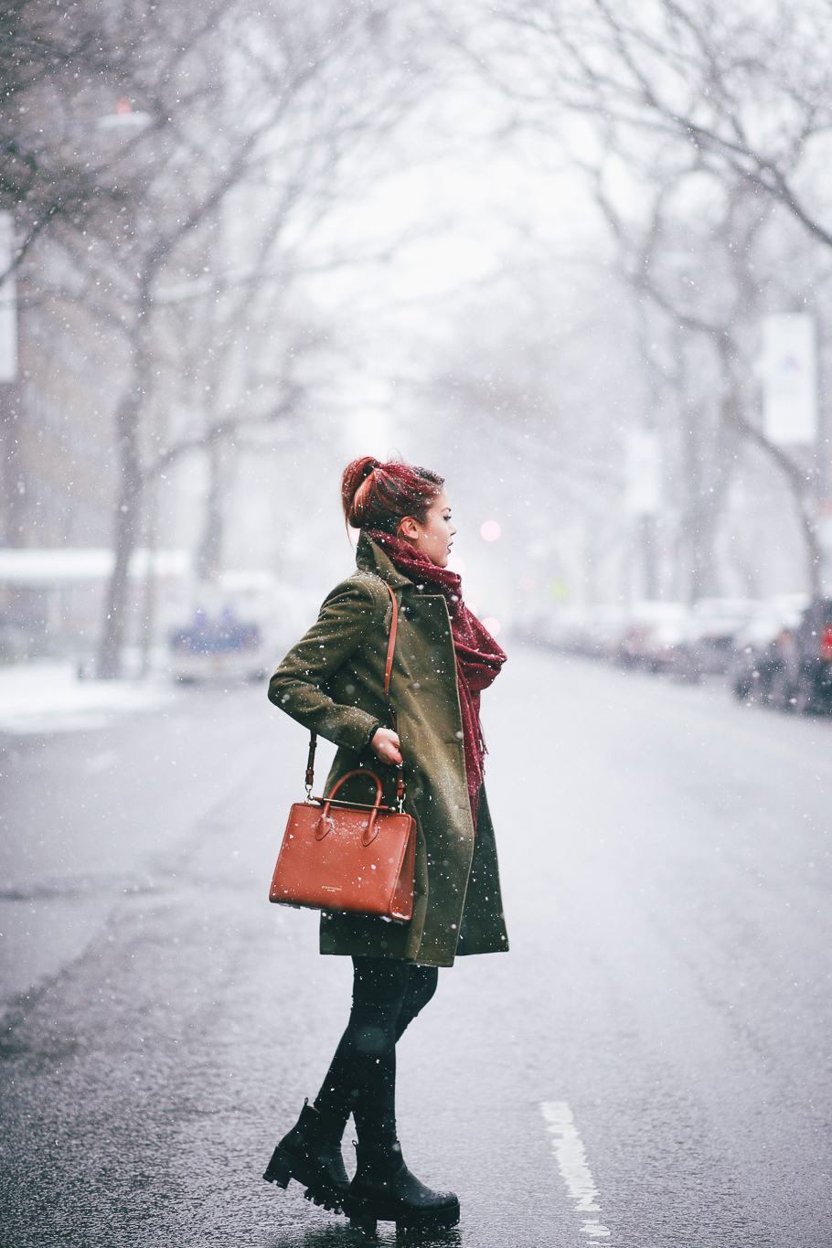 Le Happy wearing green coat in Central Park
