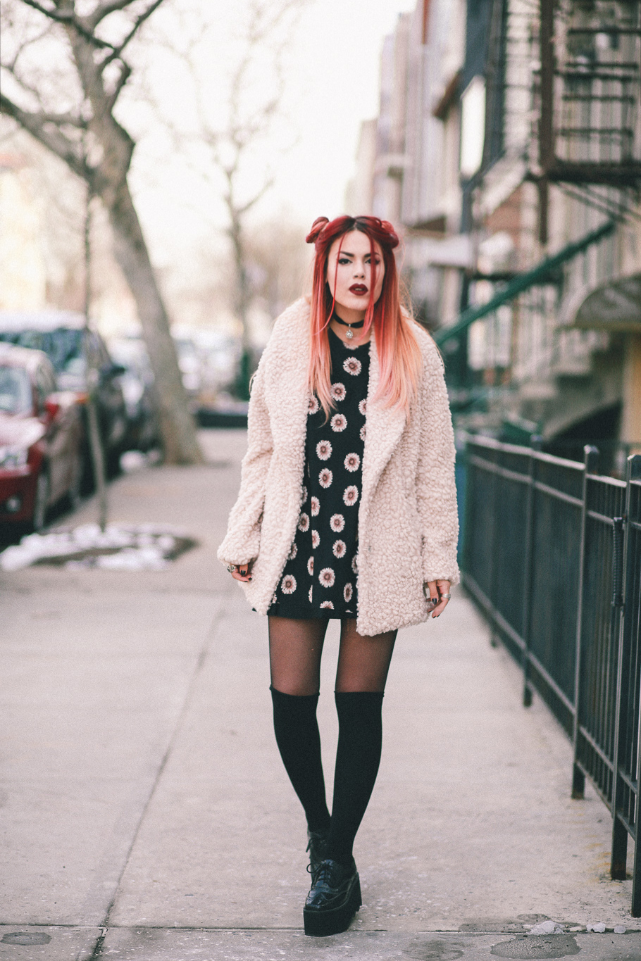 Le Happy wearing Willow & Clay coat and thigh high socks