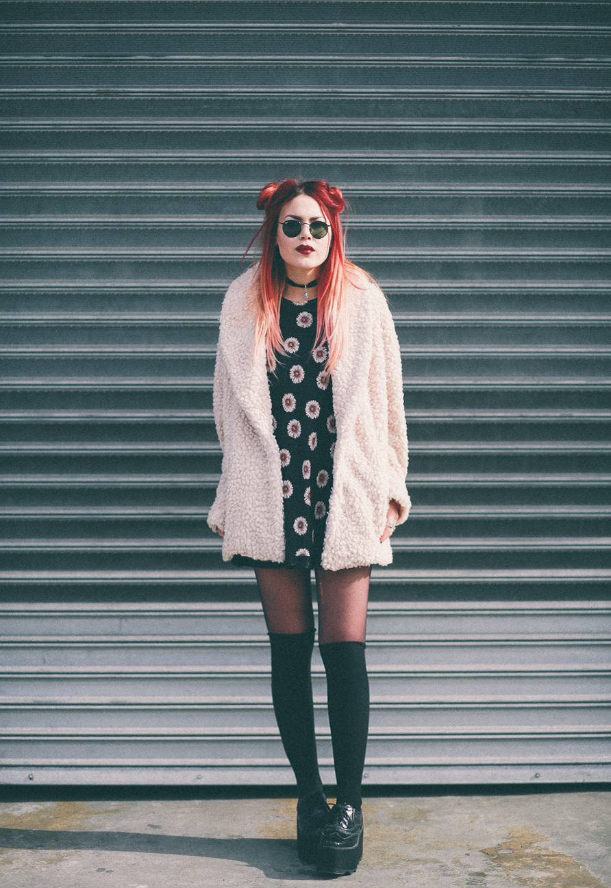 Le Happy wearing Willow & Clay coat round Ray Ban sunglasses