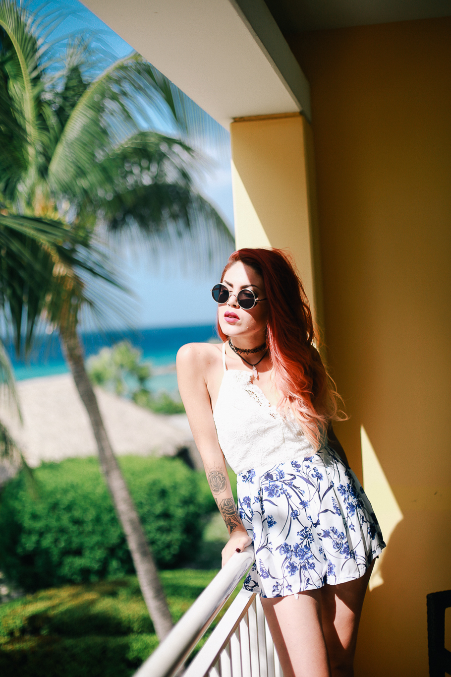 Le Happy wearing lace romper in Curacao