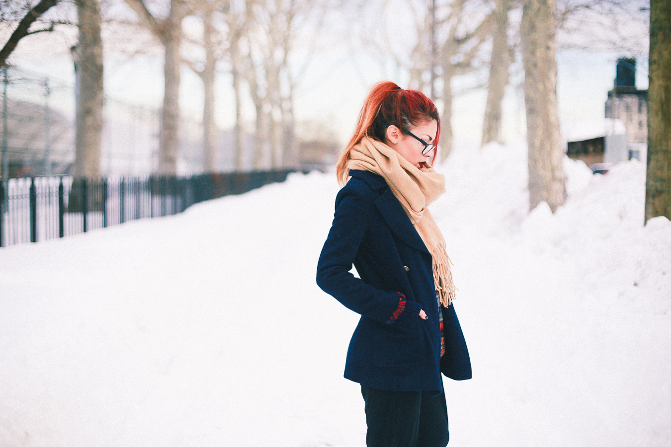 Le Happy wearing navy blazer and Few Moda scarf