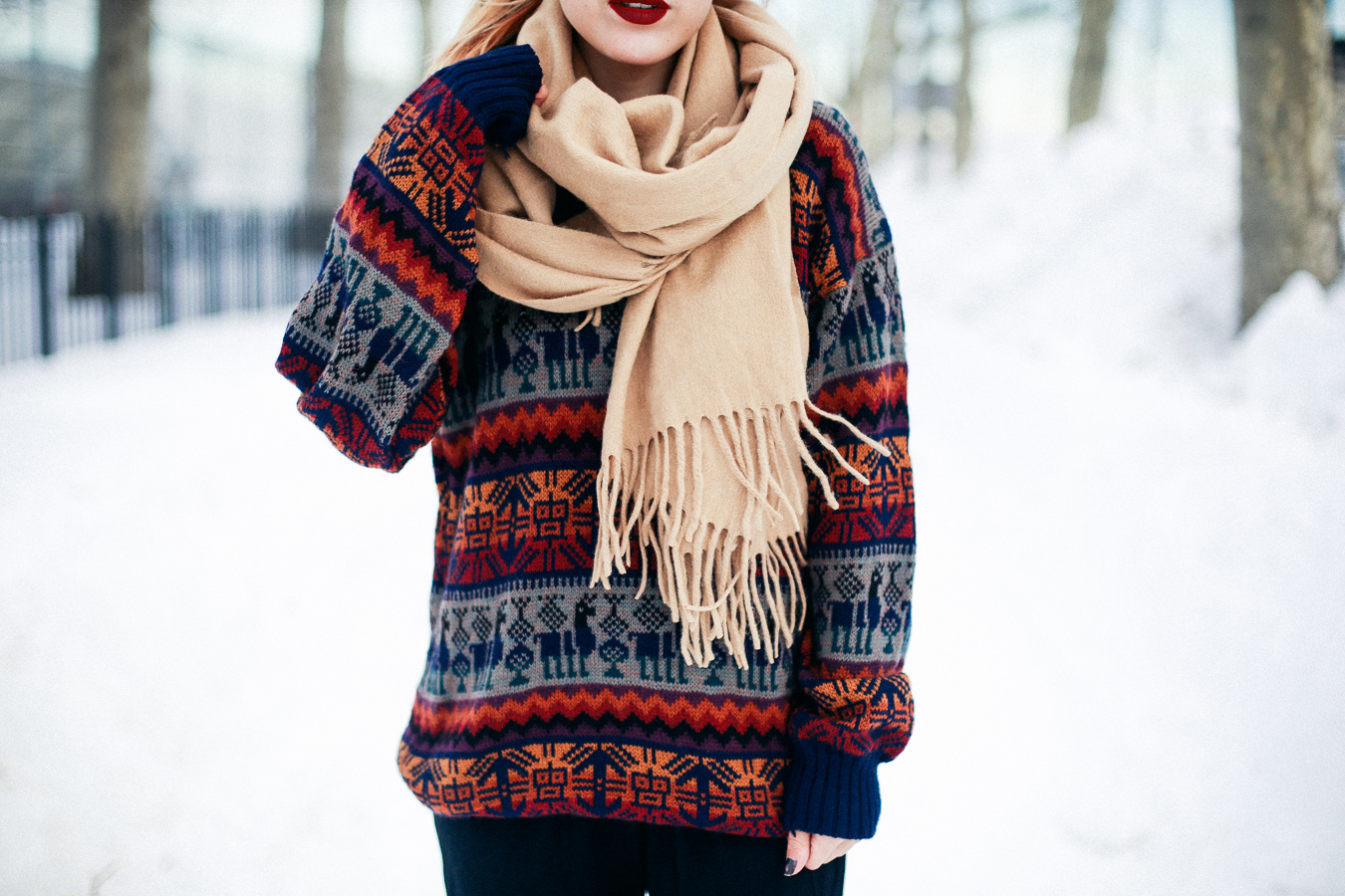 Le Happy wearing peruvian sweater and chunky scarf