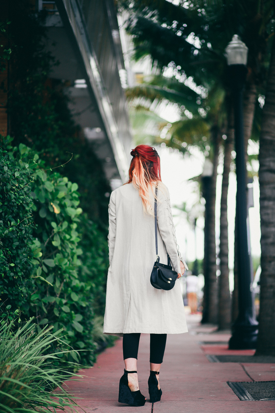 Le Happy in Miami wearing Hansen and Gretel and Chloe bag