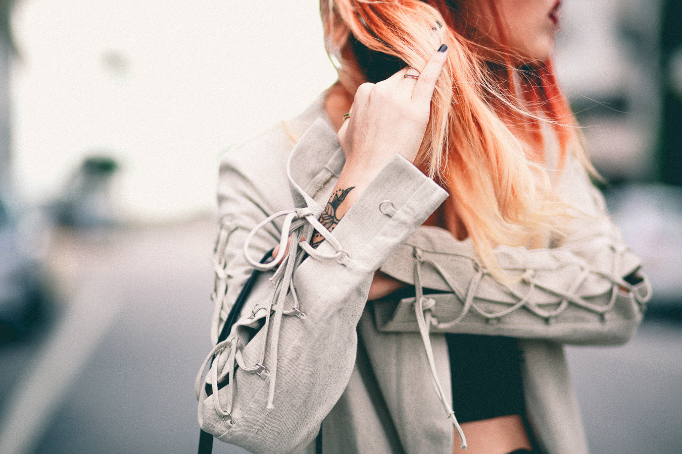 Le Happy wearing Hansen and Gretel lace up coat