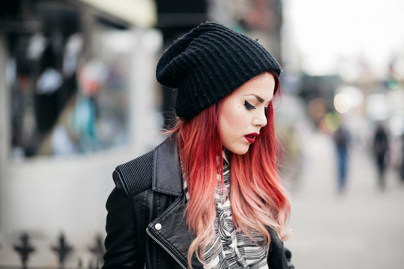 Le Happy wearing beanie and biker jacket