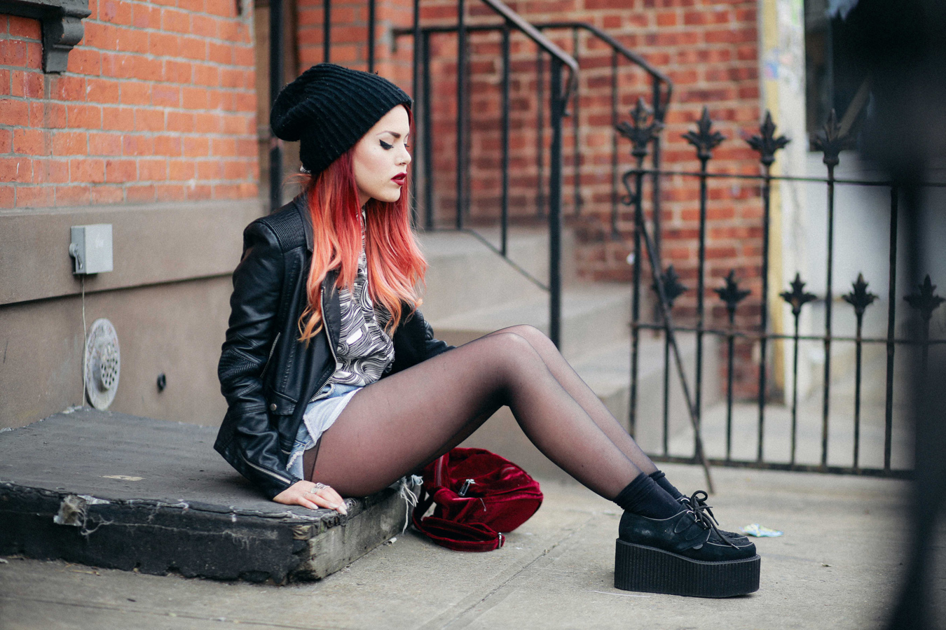 Le Happy wearing biker jacket and creepers