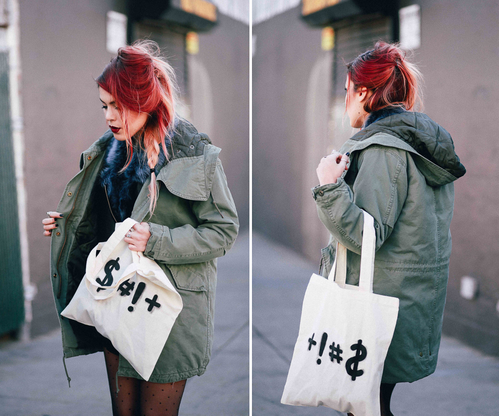 Le Happy wearing Obey green parka and canvas tote