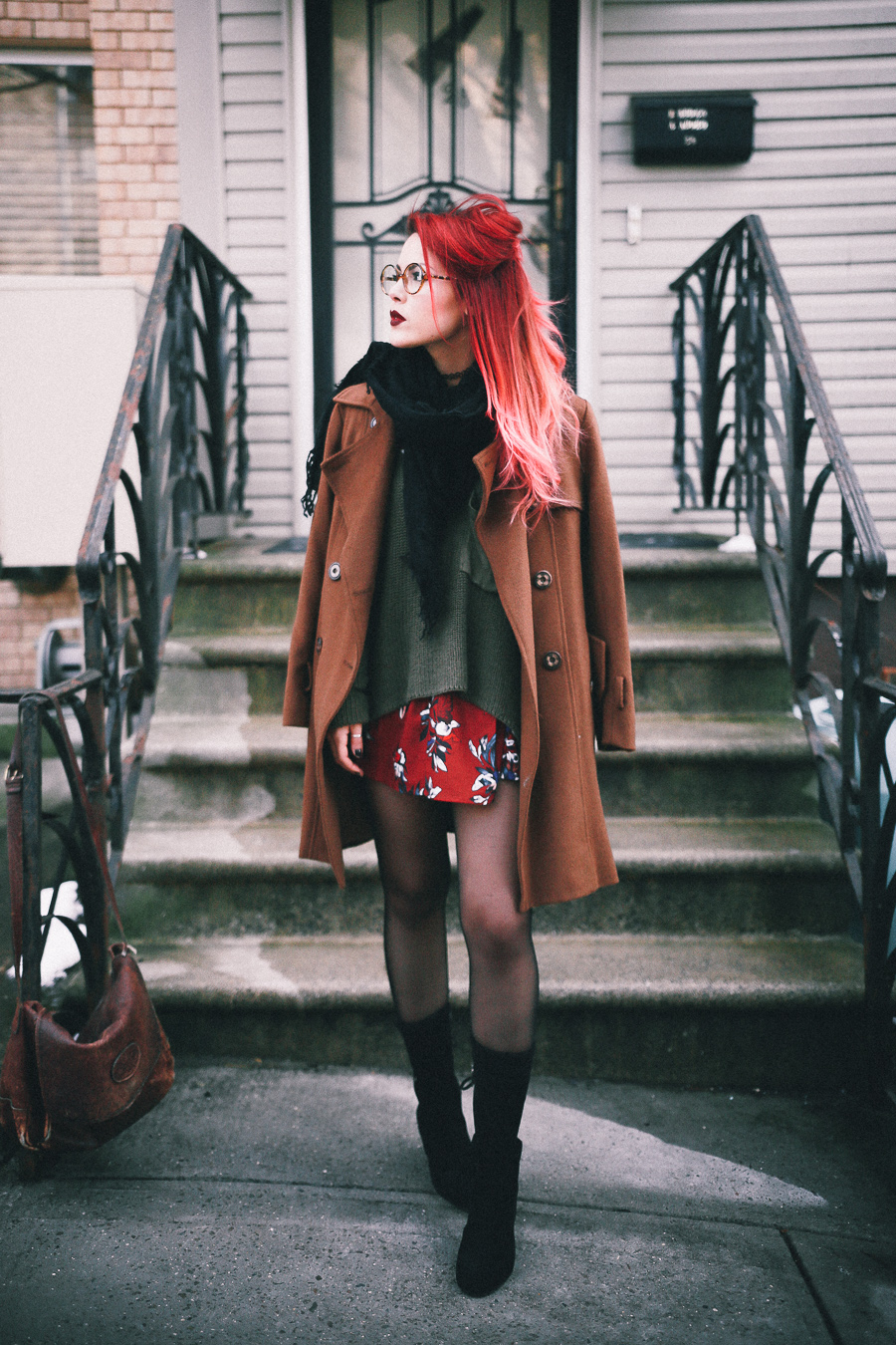 Le Happy wearing fall colors with black suede booties