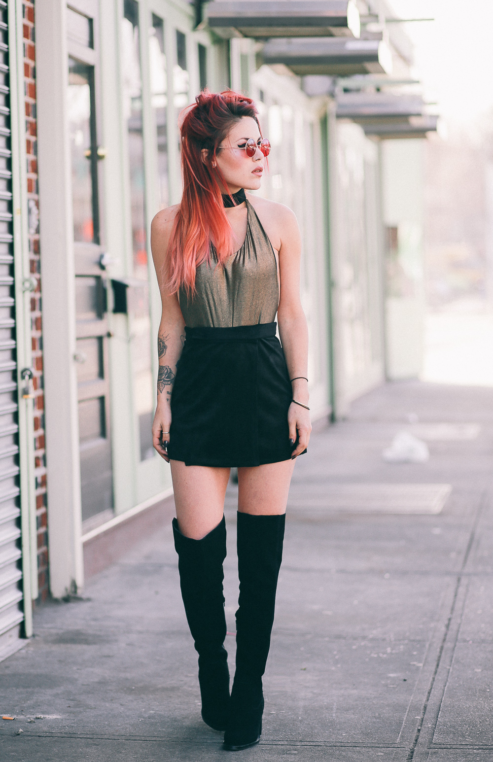 Le Happy wearing metallic bodysuit from Nasty Gal and round sunglasses