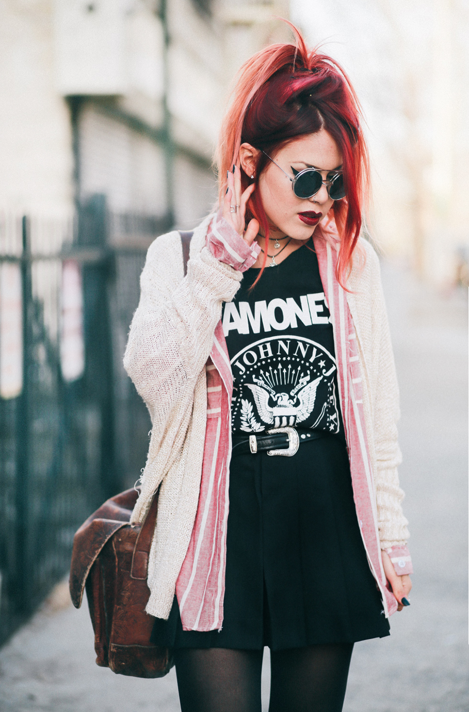 Le Happy wearing Ramones tank and a pleated skirt