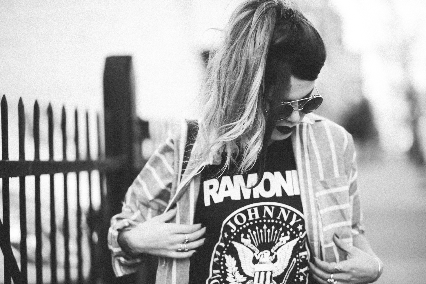 Le Happy wearing Ramones t-shirt and round sunglasses