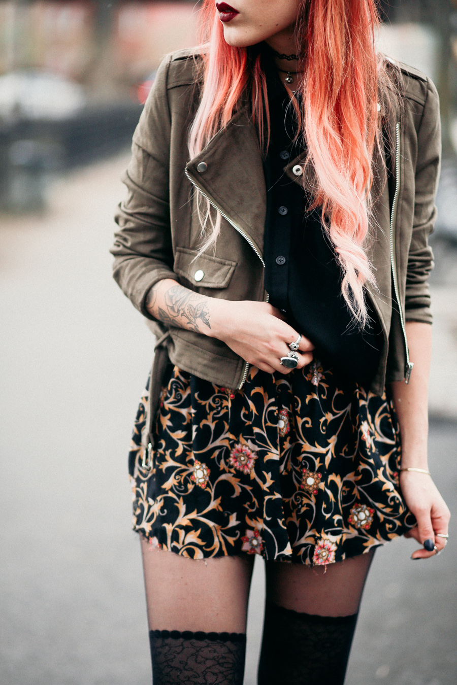 Lua wearing Missguided suede biker jacket and floral mini skirt