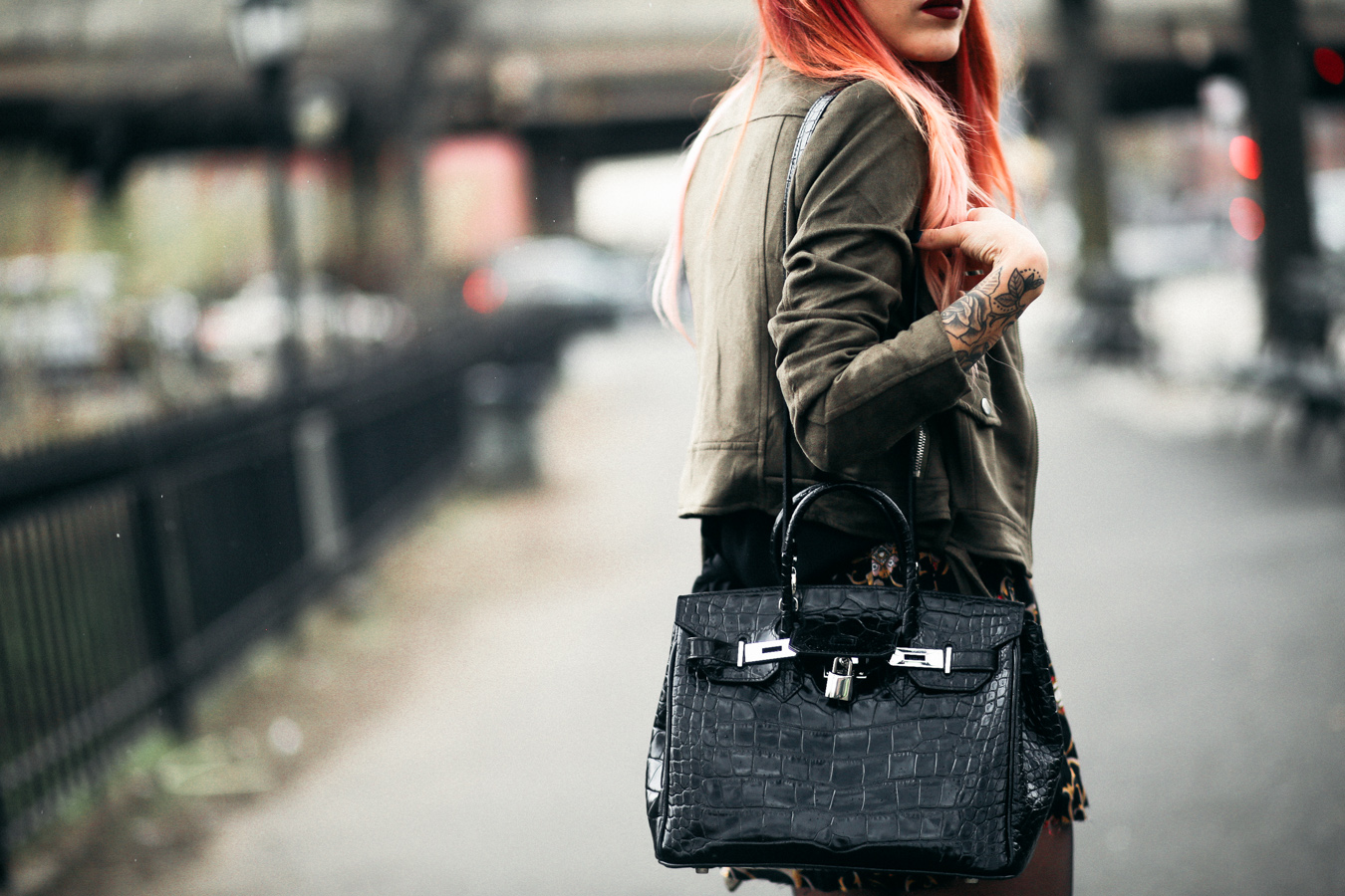 Le Happy wearing Teddy Blake croc bag