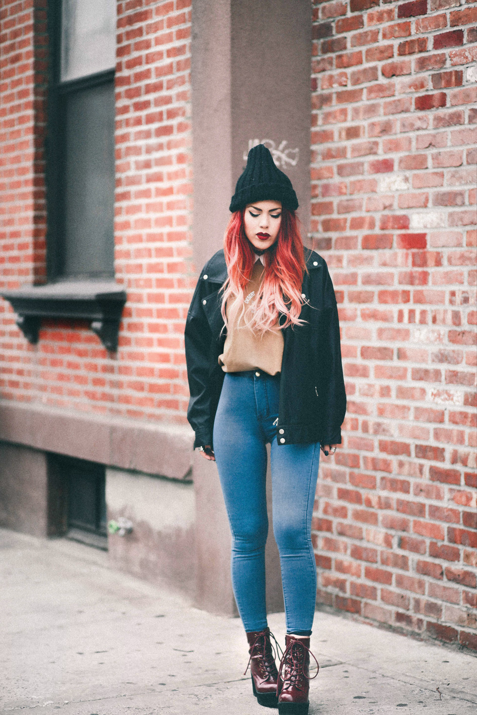 Lua wearing boyfriend biker jacket and red wedge boots