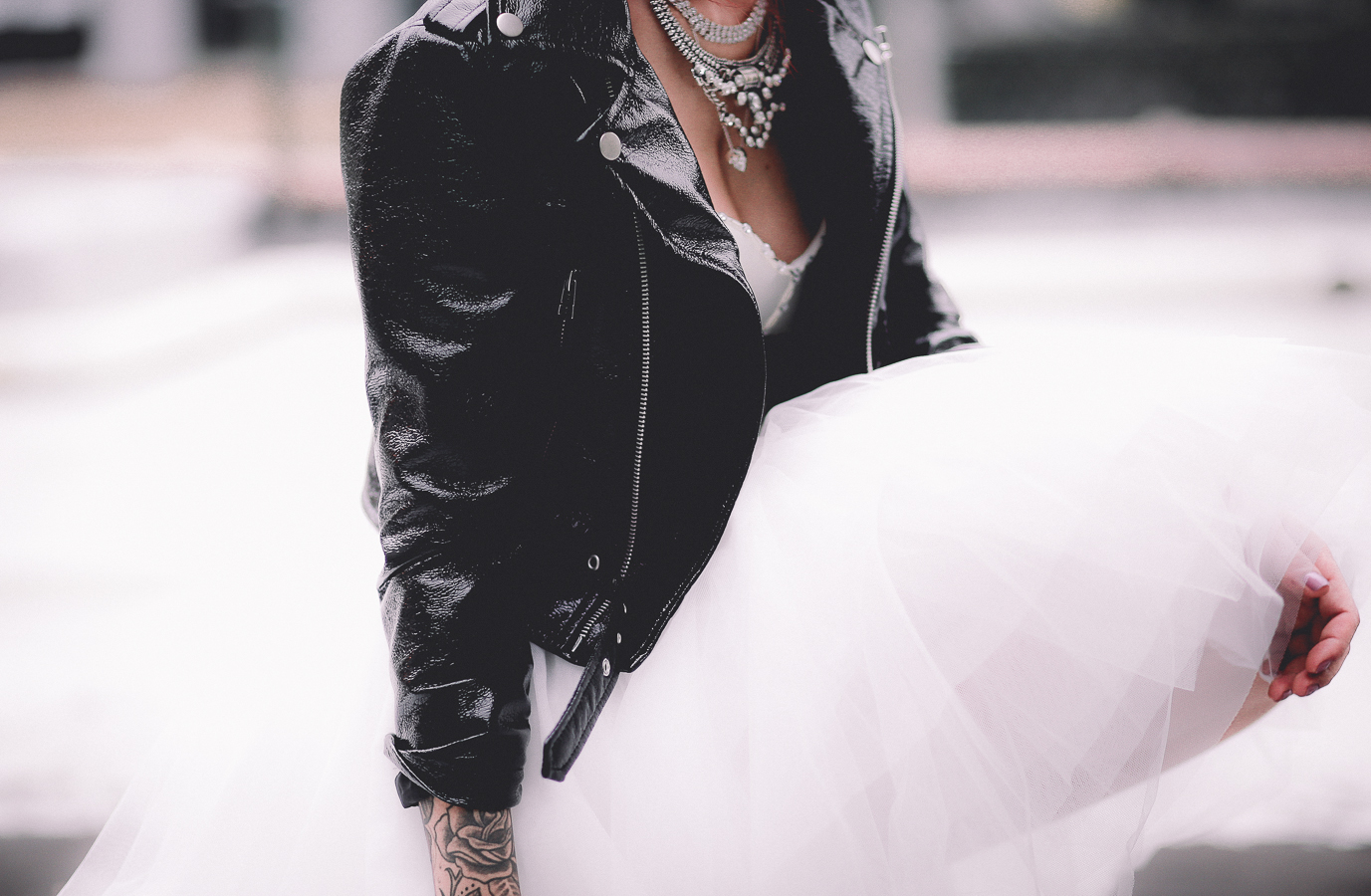 Le Happy wearing Nasty Gal Prom tulle dress and moto jacket