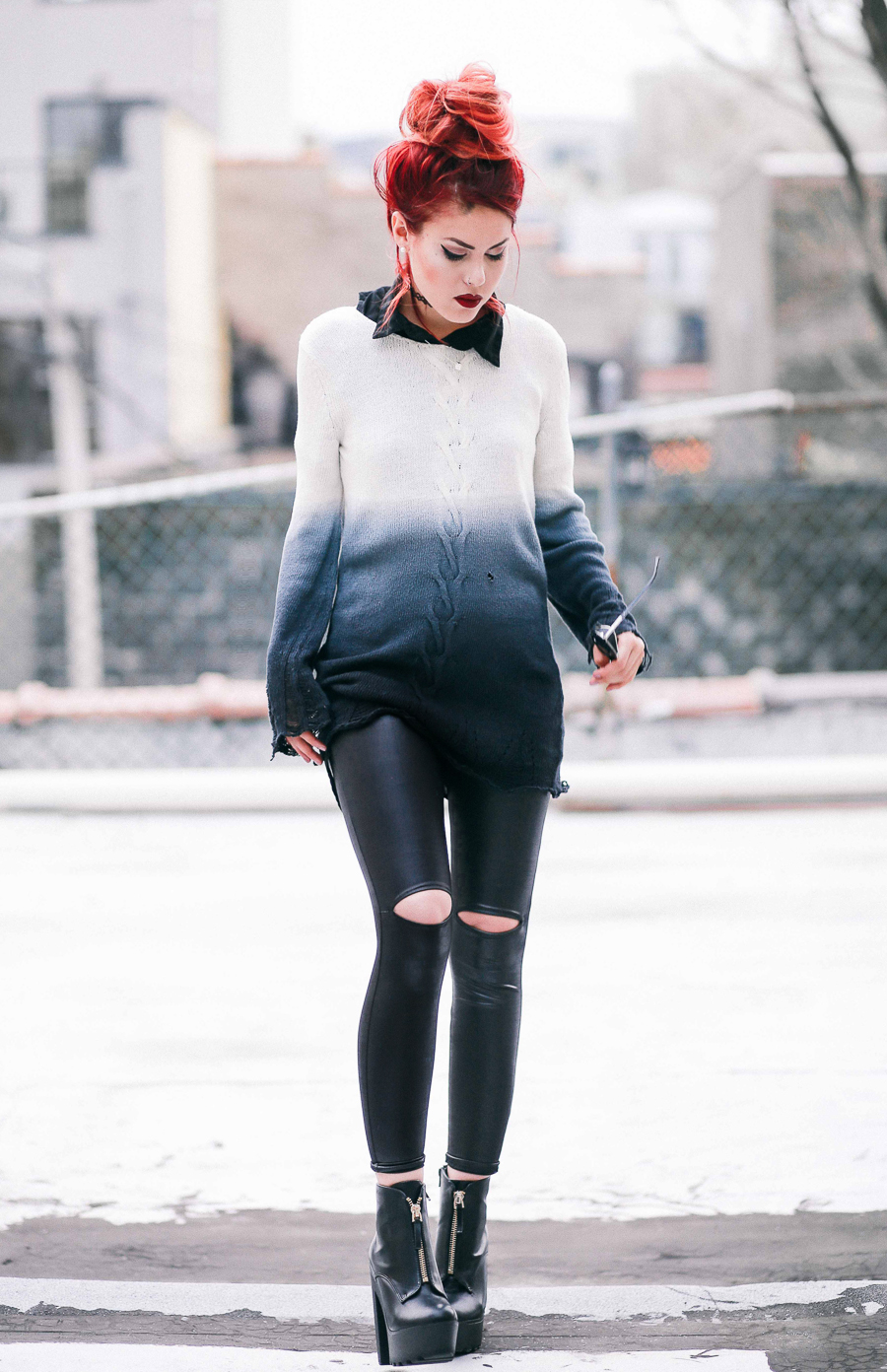 Le Happy wearing ombre sweater and leather leggings