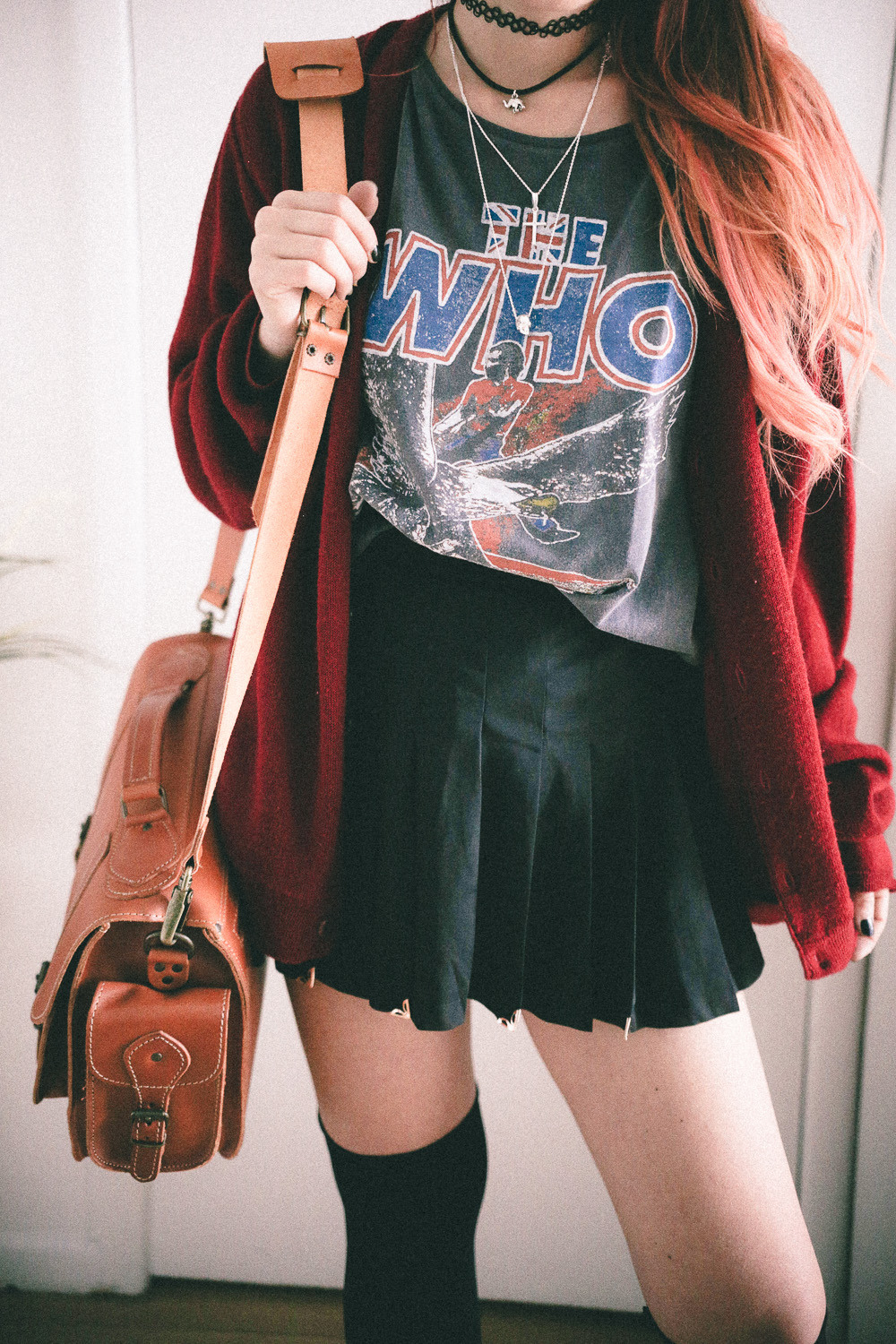 Le Happy wearing The Who t-shirt and messenger bag