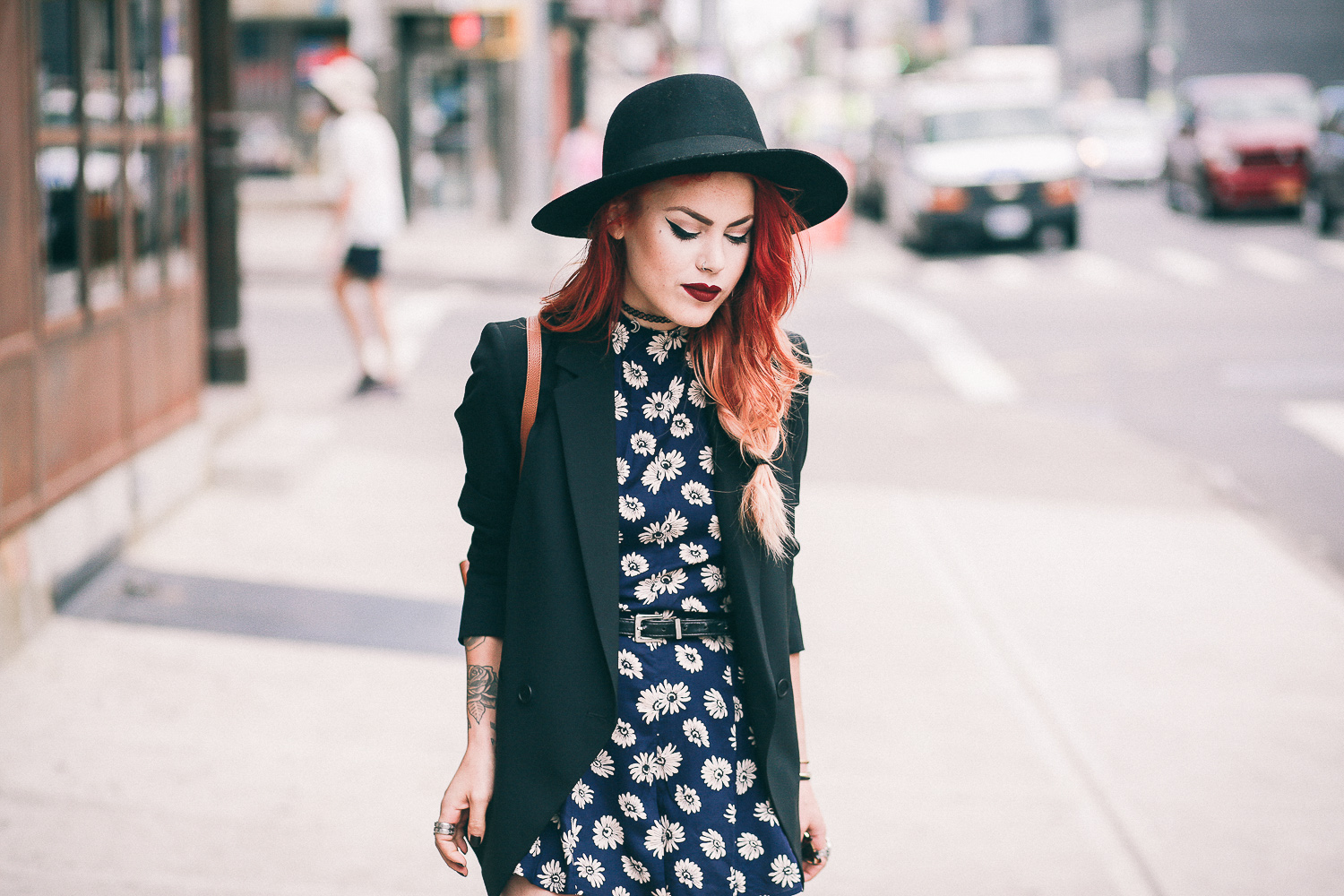 Le Happy wearing ASOS floral romper and Theory black blazer