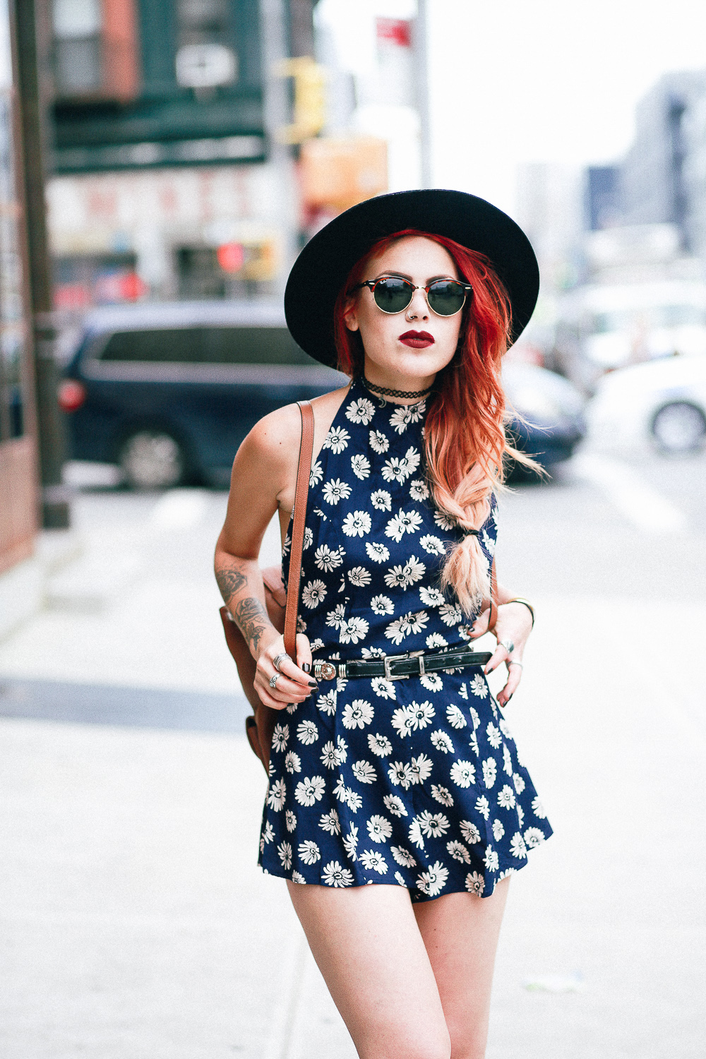 Le Happy wearing floral romper from Asos  and a fedora hat