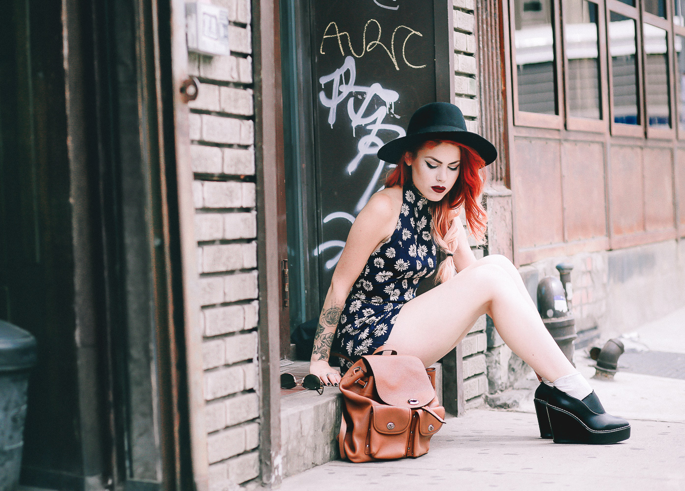 Le Happy wearing ASOS floral romper and Coach backpack