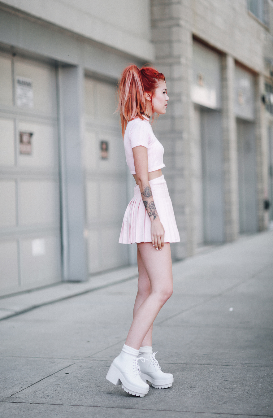 Le Happy wearing a pastel pink set and Melissa shoes