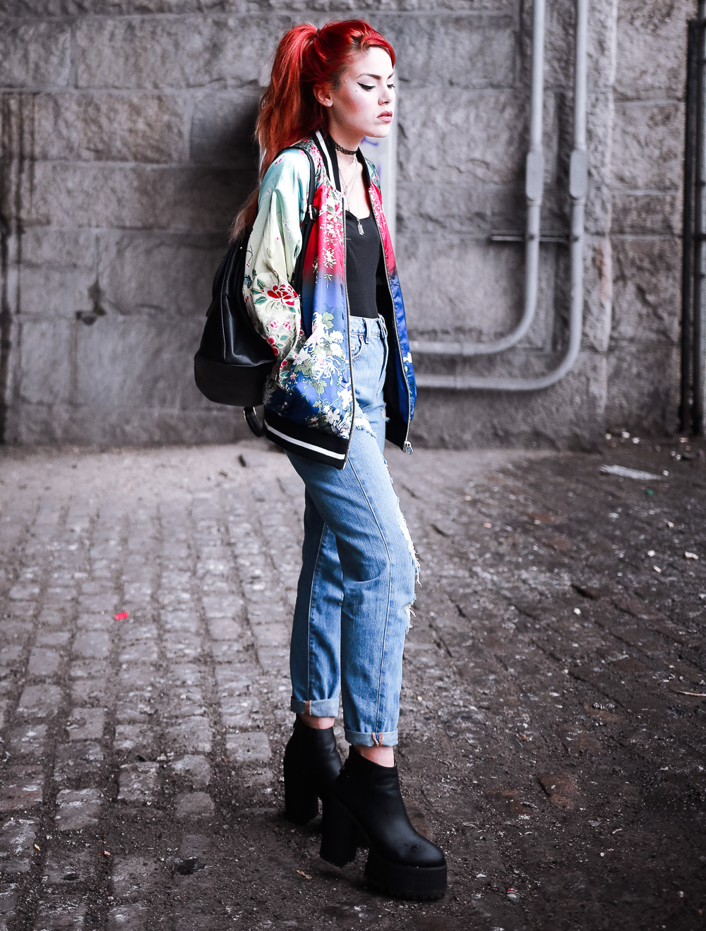 Le Happy wearing Asos bomber jacket and ripped jeans