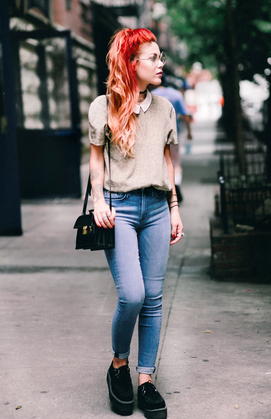 Le Happy wearing Barbara Hudson Jeans and Saint Laurent High School Satchel