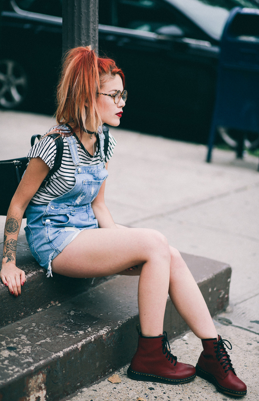 Le Happy wearing red Dr Martens Newton and ASOS overalls