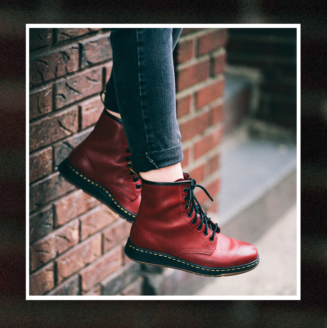Le Happy wearing red Dr Martens Newton Lites
