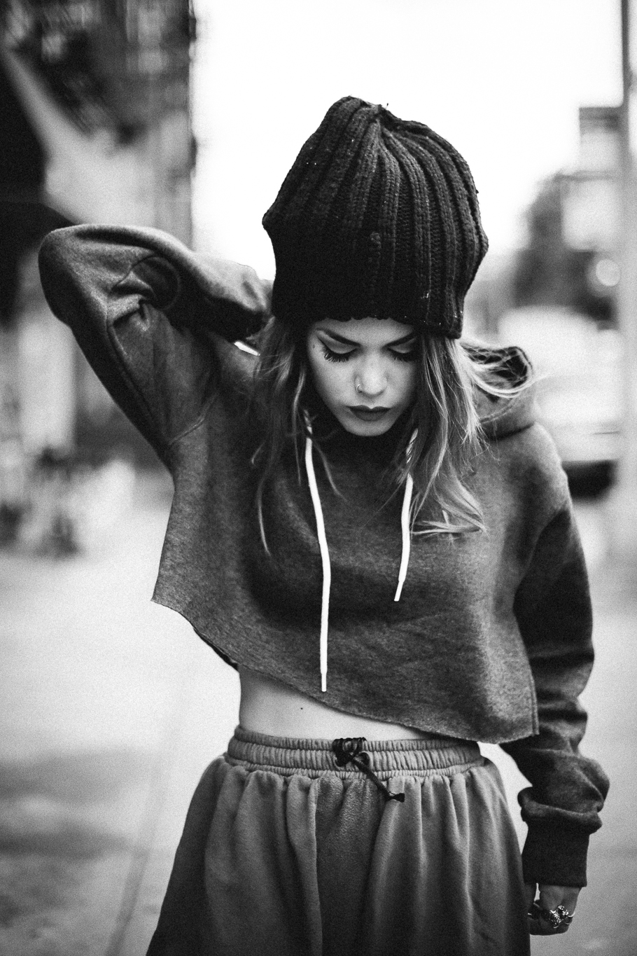 Le Happy wearing cropped hoodie and a beanie