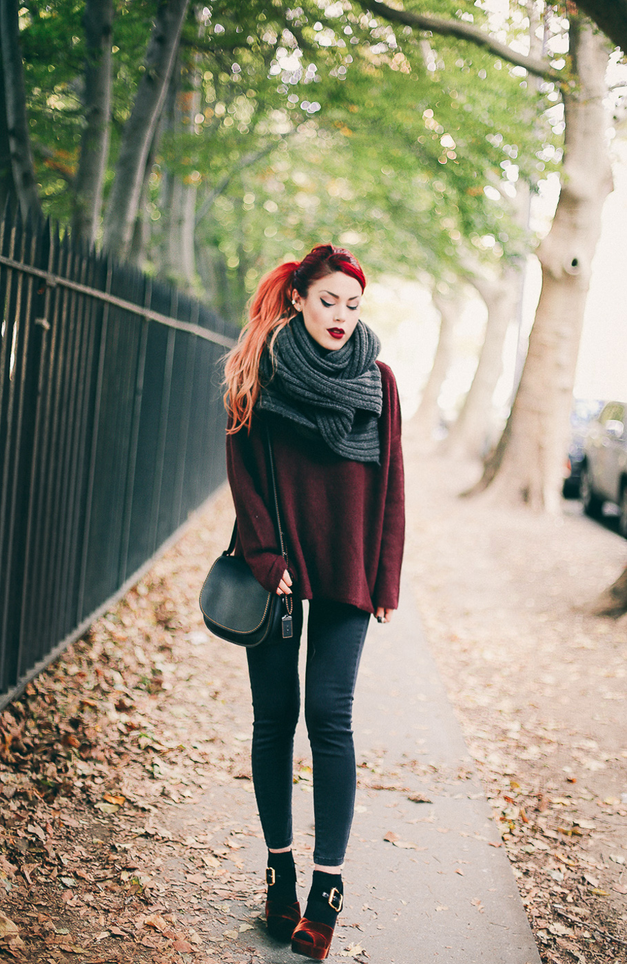 Le Happy wearing Coach 1941 crossbody bag and Vince burgundy sweater