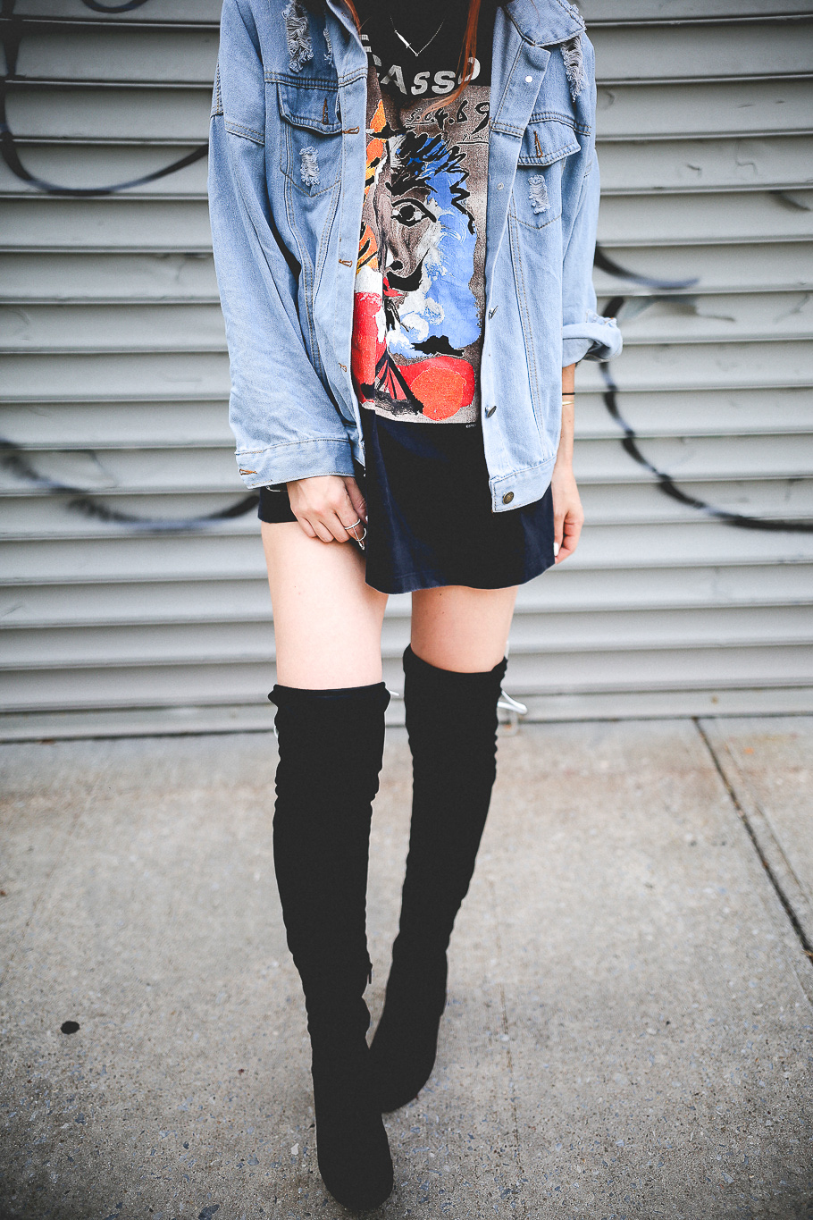Le Happy wearing McQ thigh high boots and denim jacket