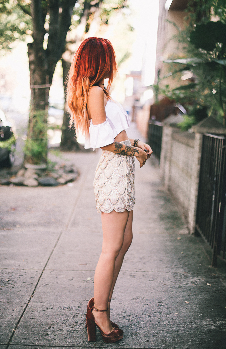 Le Happy wearing Kendall and Kylie top and sequined skirt