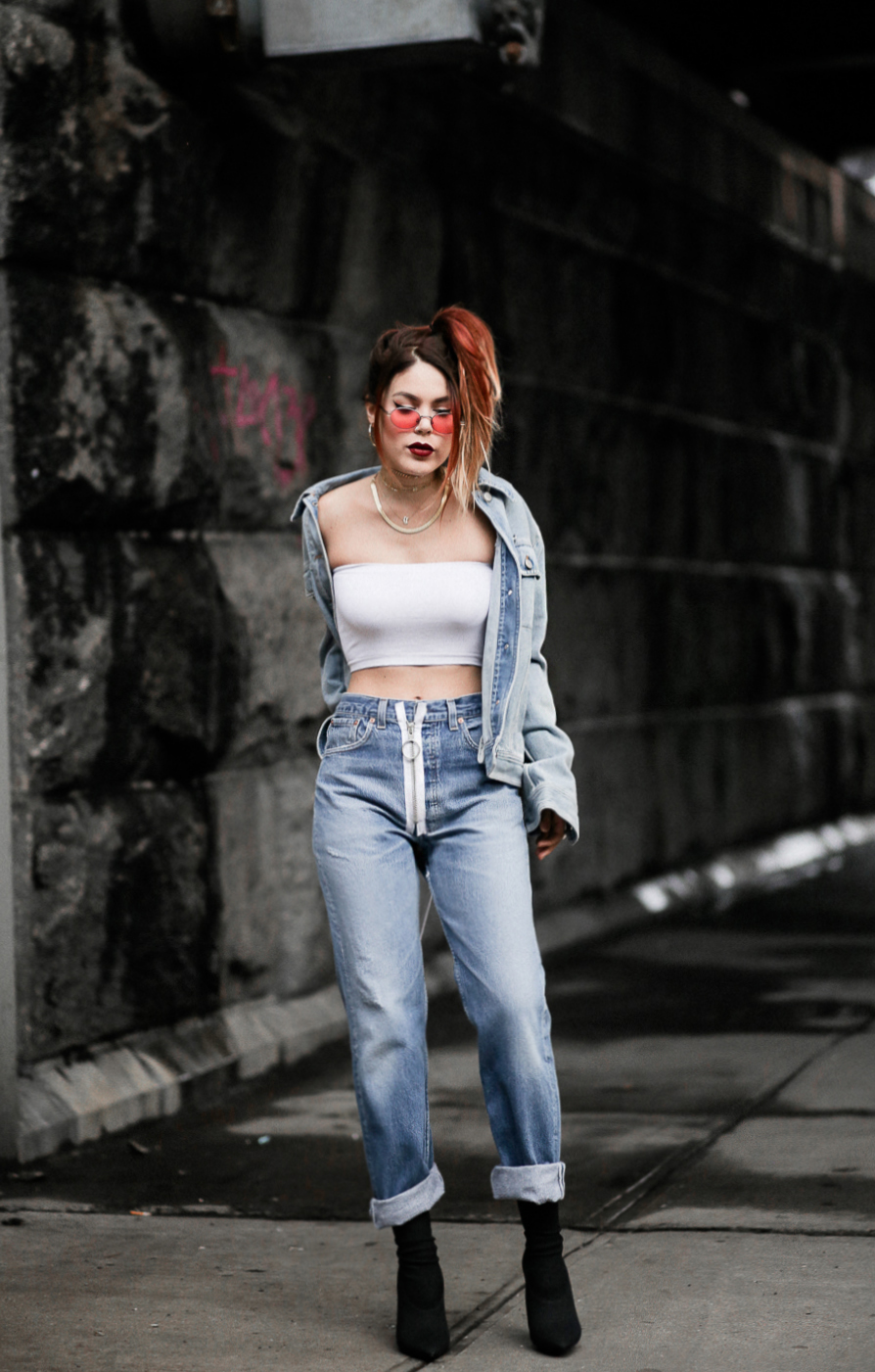 Luanna wearing Off White jeans and MM6 distressed denim jacket with Yeezy boots