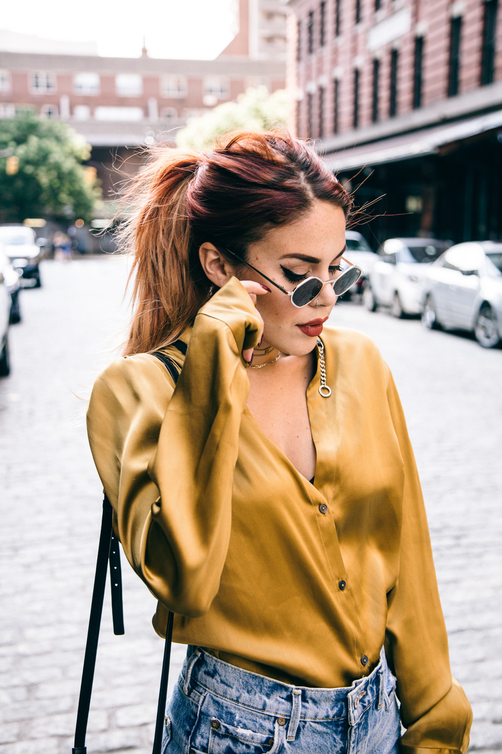 Lua wearing Public School mustard blouse and Quay x Kylie Jenner sunglasses