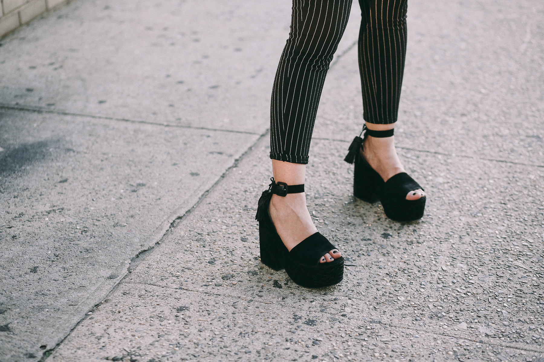 Platform sandals paired with striped pants