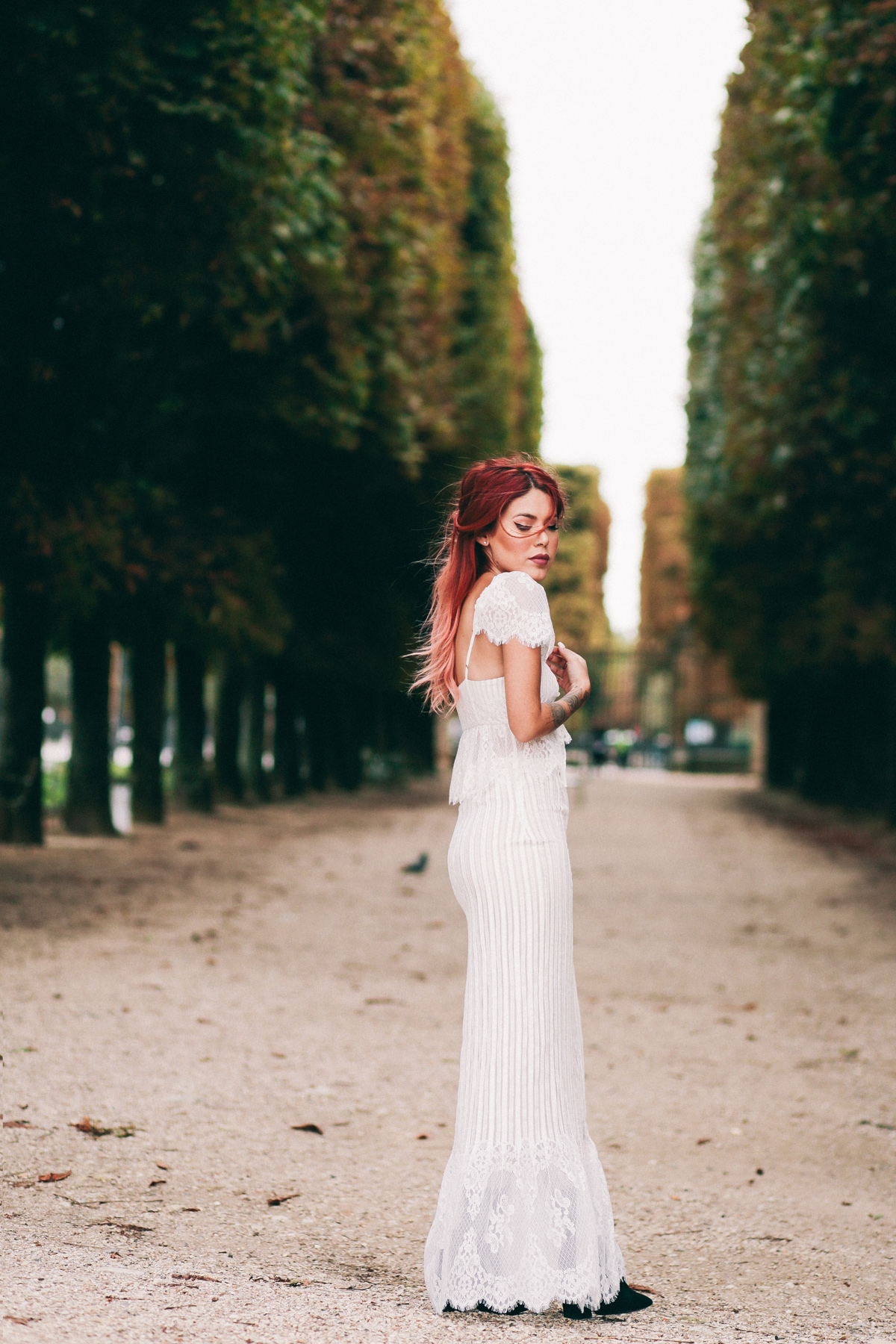 Le Happy wearing a lace Stone Cold Fox Dress at the Luxembourg Gardens